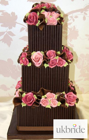 Dark-choc-scroll-&-pink-rose-wedding-cake.jpg