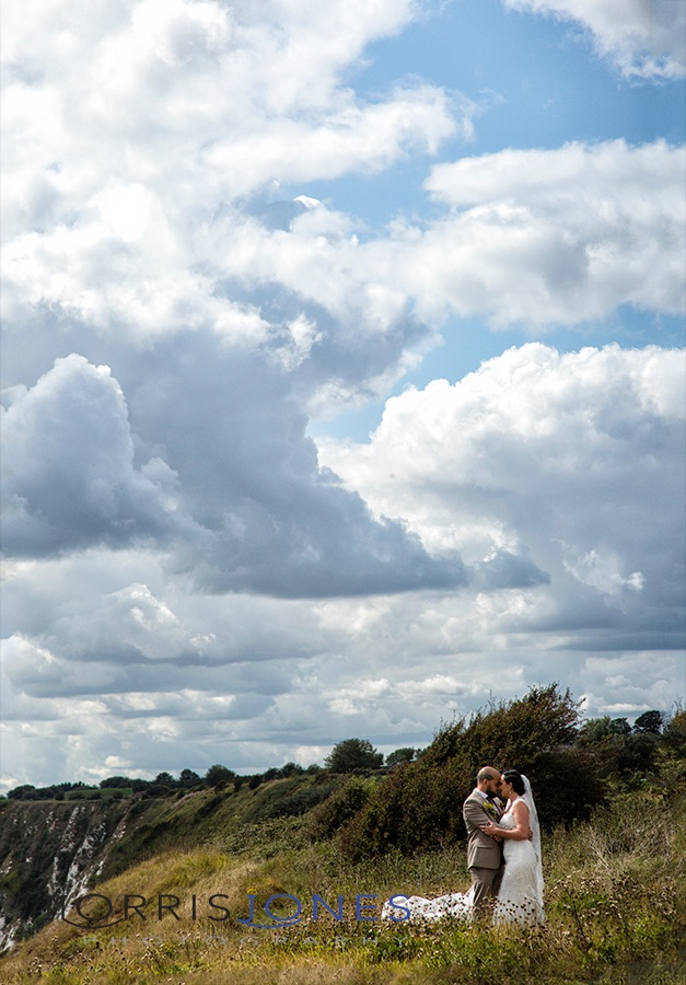 The drama of a billowing cloudy sky, the White Cliffs and a beautiful couple.
