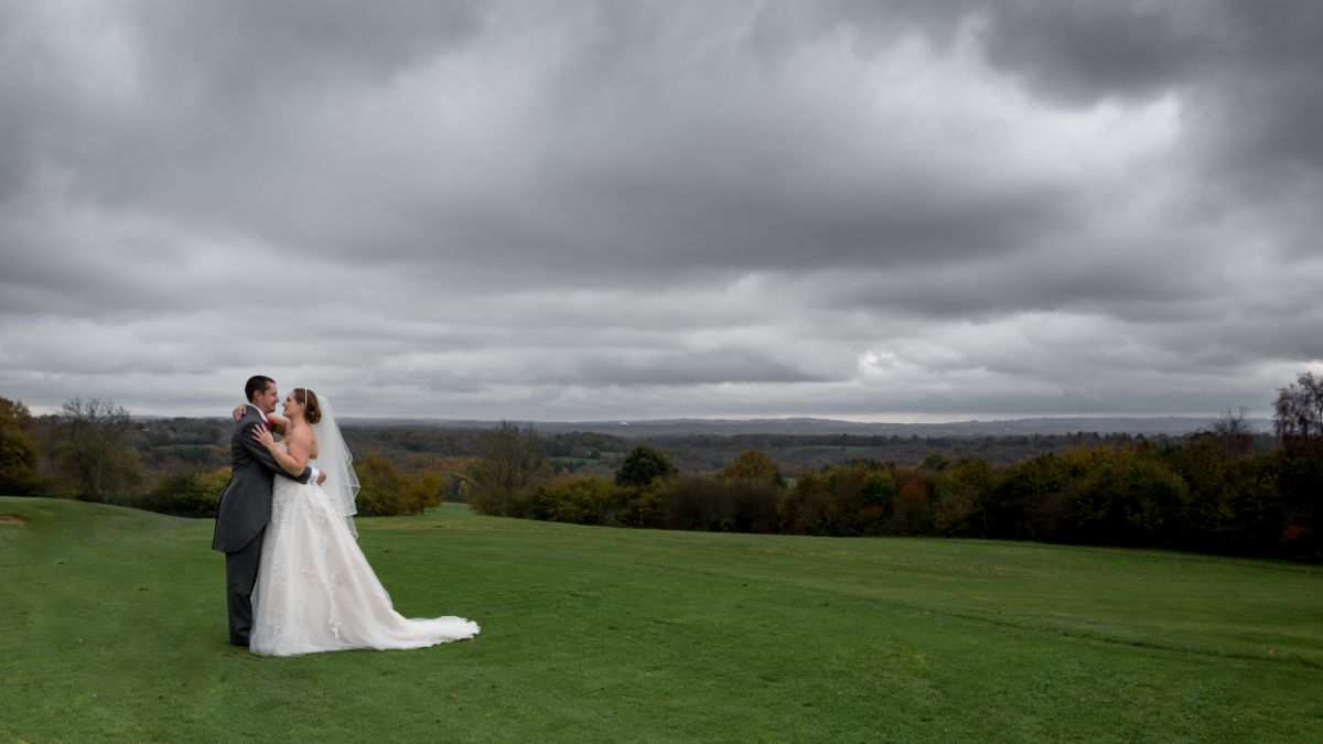 The dramatic clouds over-looking the beautiful couple.