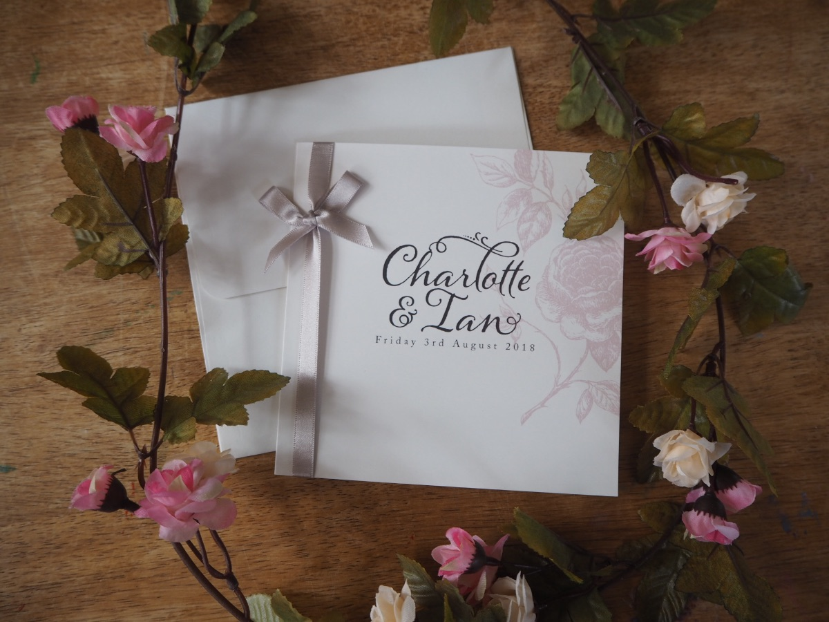 Vintage Rose 150mm square invitations in blush and charcoal with oyster satin ribbon