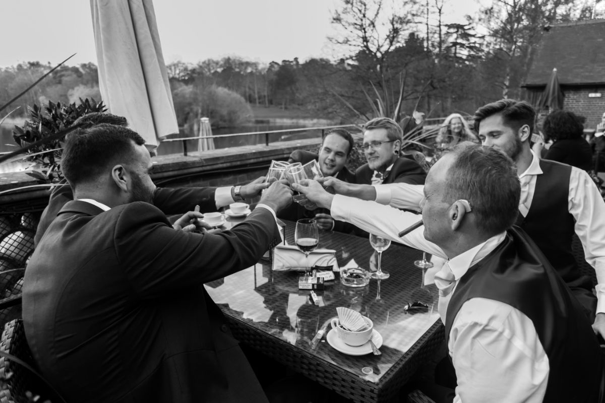 Male bondng time with cigars and drinks