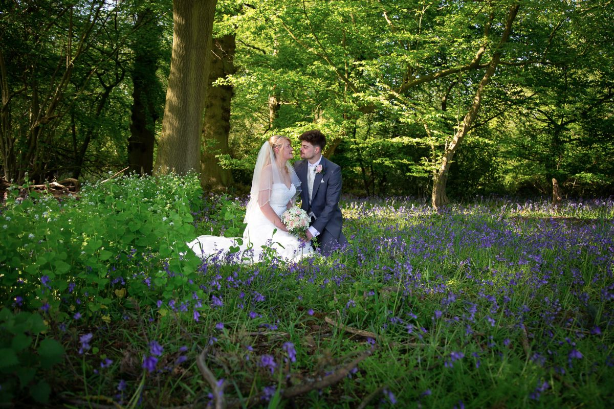 Andrew and Sophie surrounded by bluebells