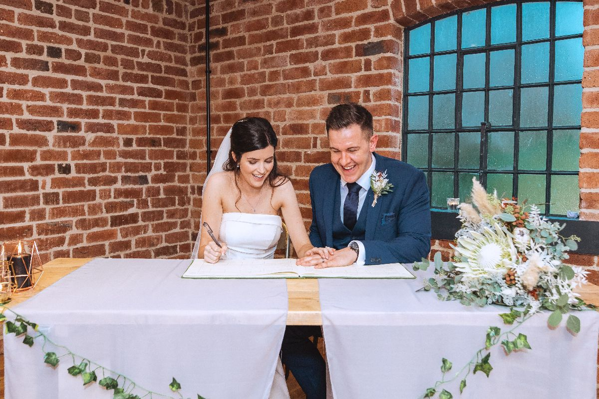 Sean & Abby sign the wedding register following their civil ceremony at Haarlem Mill.