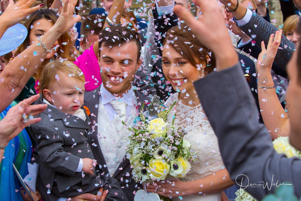 Stephanie And Tom at St.Nicholas church Shepperton and confetti time
